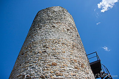 Big tower of a medieval castle facing the sky