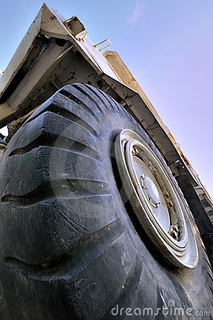 Big tyre and construction loader under sky