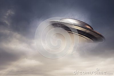 Big UFO emerging from the clouds