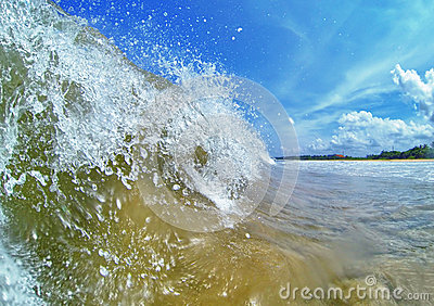 Big wave on a tropical beach