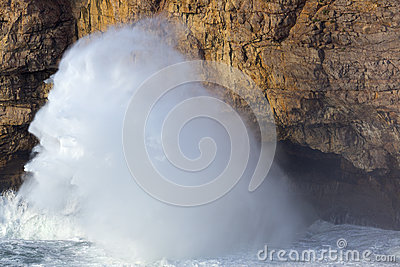 Big waves on cliff