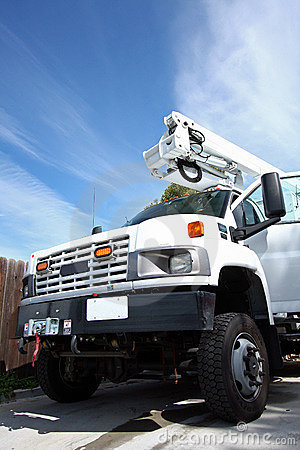 Big white diesel truck with boom
