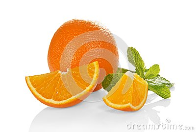 Big whole orange, slices of orange and the mint