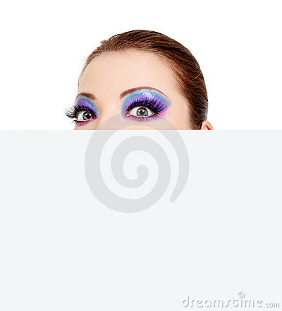 Big wondering femalel eyes and blank banner