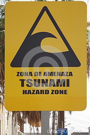 Free Big Yellow Tsunami Warning Sign On The Street Of Iquique Chile Stock Photos - 64692833