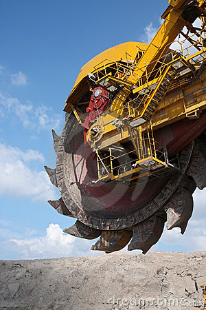 Big yellow wheel of coal excavator
