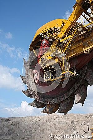 Big yellow wheel of coal excavator