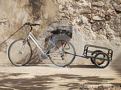 Bike and a carry case in a wall.