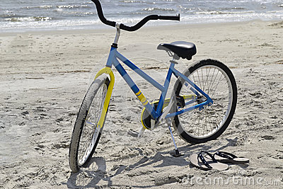 Bike and flip-flops at the beach