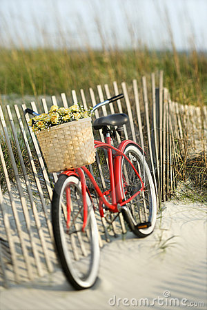 Free Bike Leaning Against Fence At Beach. Royalty Free Stock Photo - 2038335