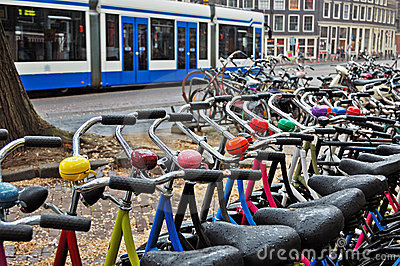 A bike rental station on a rainy day in Amsterdam