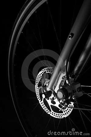 Bike tire, axel, hub and spokes black background