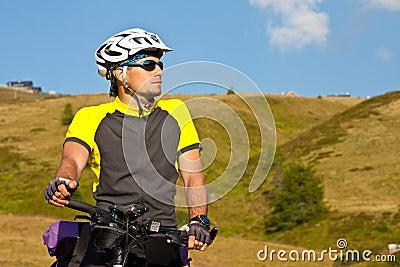 Biker beside a beautiful mountains