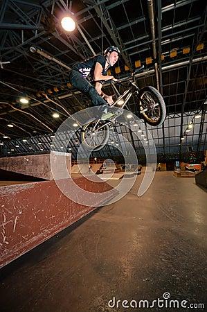 Biker doing bar spin drop trick