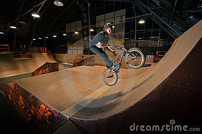 Biker doing bar spin trick