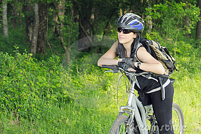 Biker in forest Stock Photo