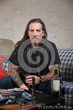 Biker Gang Member with Weapons and Alcohol