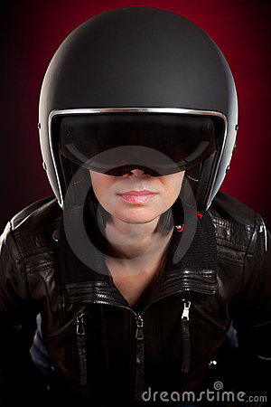 Biker girl in a helmet