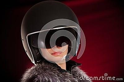Biker girl in a helmet