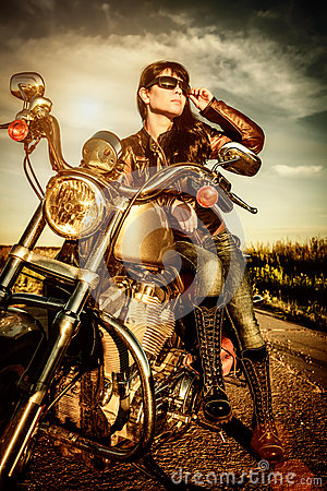 Free Biker Girl On A Motorcycle Royalty Free Stock Photo - 32416345