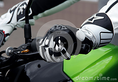 Biker hands rests on the steering wheel motorcycle