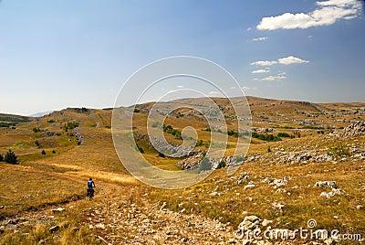 Biker on mountain plateau