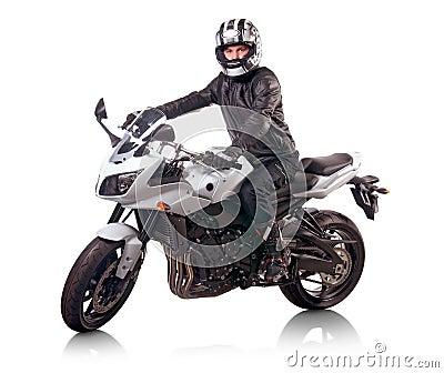 Biker rides white motorcycle