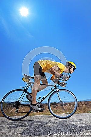 Biker  riding a bike on an open road