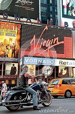 Biker riding Harley Davidson on Times Square Editorial Stock Photo