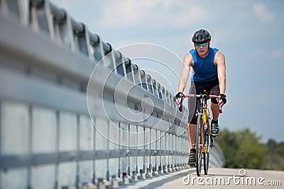 Biker riding on race  road bike