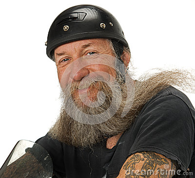 Biker smiles as the wind blows through his beard
