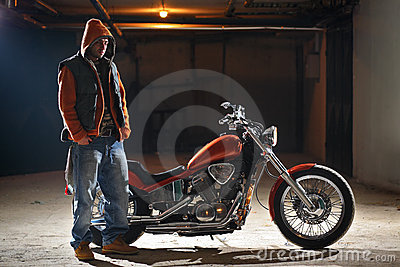 Biker standing next to a bike