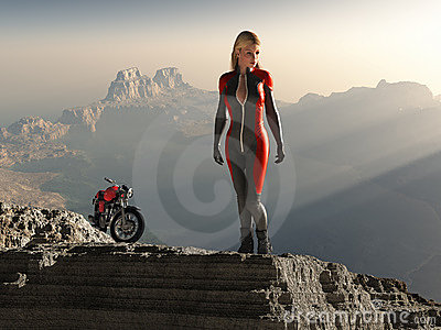 Biker woman on mountain peak