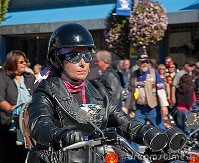 Biker Woman Riding in Oyster Run Event Editorial Image