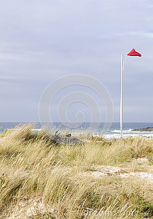 Bikes and mast on the beach