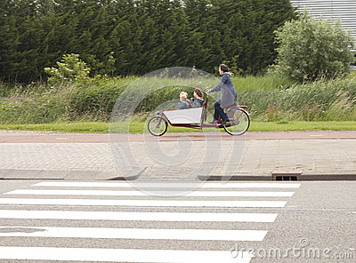 Biking the children to school in the Netherlands Editorial Stock Image