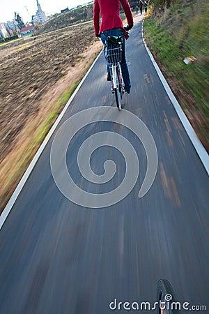 Biking  - young woman biking to work