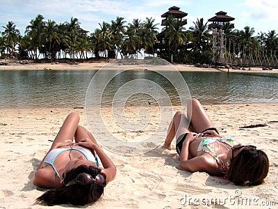 Bikini ladies sunbathing