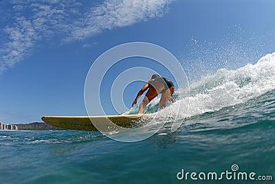 A bikini longboard surfer