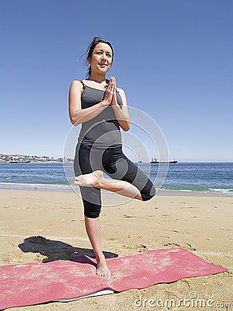 bikram yoga tadasana pose at beach stock photos  image