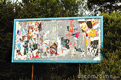 Billboard with old torn posters