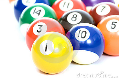 Billiard balls arranged on a white background