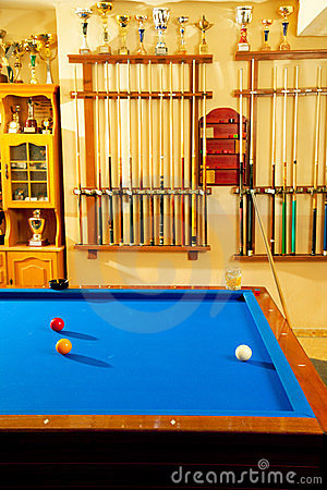 Billiard club with blue pool table cue and trophy