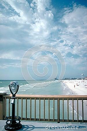 Binoculars and boardwalk on beach
