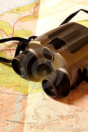 Binoculars on map