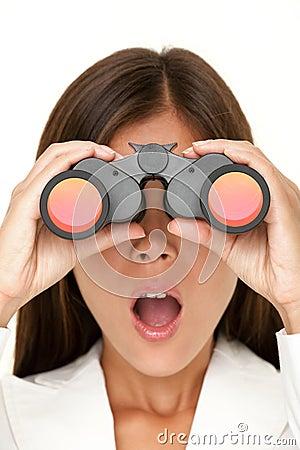 Binoculars woman looking surprised