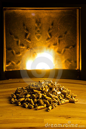 Biomass pellets illuminated by flame from heater