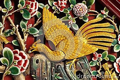 Bird carved on wood