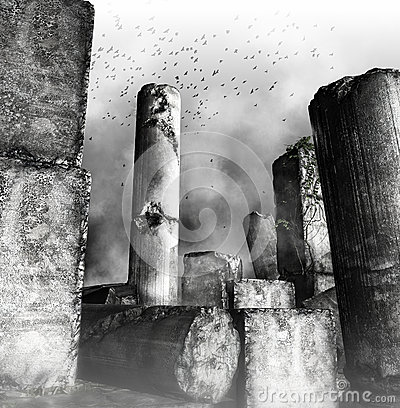 Birds flying over ruined columns
