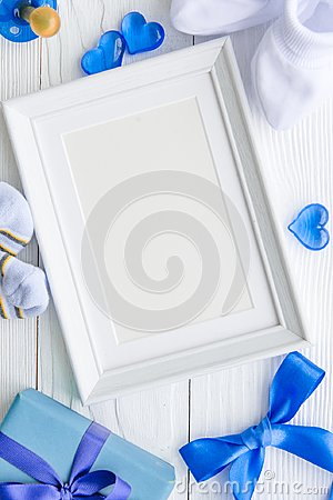 Free Birth Of Child - Blank Picture Frame On Wooden Background Stock Photography - 99889852